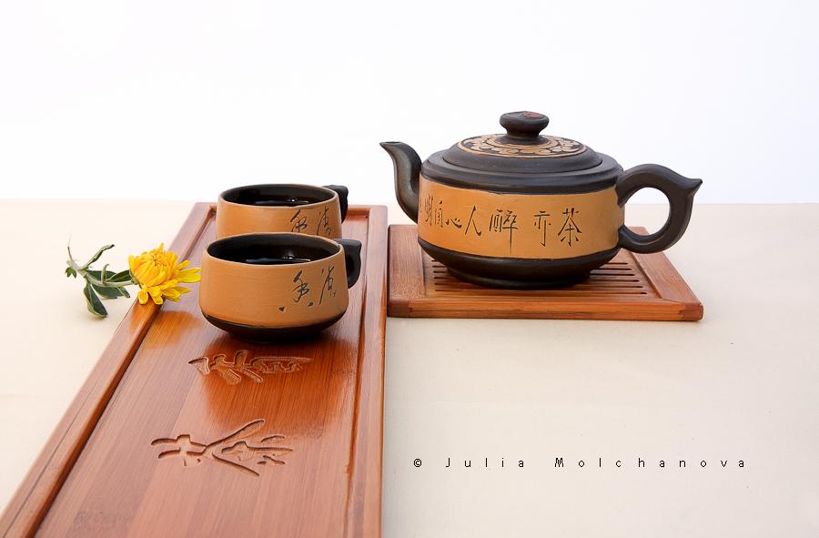 Chinese teapot, tea and  yellow chrysanthemum